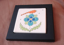 Ceramic Tile depicts Floral and bird in a black wooden frame