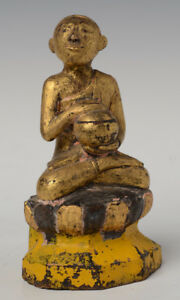 19th Century, Mandalay, Antique Burmese Wooden Seated Disciple Holding Bowl