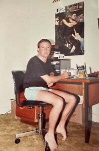 Australian Young Man U2 Poster Cassettes VHS On Desk Curled Up Toes Picture 80's