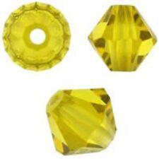 Swarovski Crystal Bicone. Citrine Color. 4mm. Approx. 144 PCS. 5328