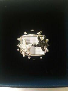 Modeschmuck/ Ring silberfarben mit einem großen Kristall und 2 Seesternen Gr.18