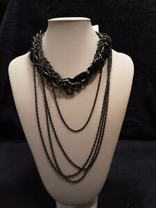 Necklace and earrings set.  Black velvet entertwined with black chains
