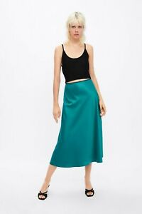 cherrie424: NWT Zara Satin Midi Skirt