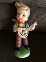 VINTAGE BOY PLAYING A BANJO FIGURINE FROM JAPAN