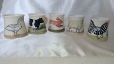 A FINE QUINTET OF HAND PAINTED MUGS BY STEVE DUFFY OF RYE POTTERY , EAST SUSSEX