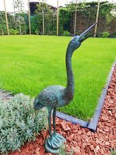 Bronze garden sculpture of a  heron