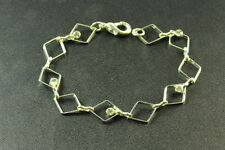 Diamond Shapes, Clear Diamante(Zx2) Contemporary Silver Tone Bracelet