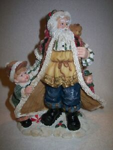 "10"" X 9""  RESIN SANTA CLAUS CHRISTMAS FIGURINE IN ORIGINAL BOX"