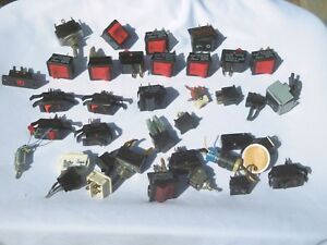 35 Assorted Switches, Mostly rocker switches.  Used pulls from electronic Equip.