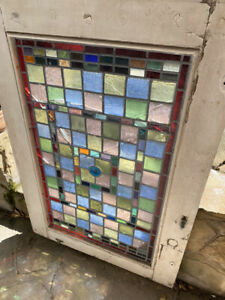 Stained glass window including frame