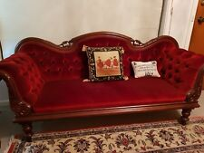 antique settee..red bttoned