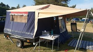 Raclet Moovea trailer tent with sun canopy and side storage brackets