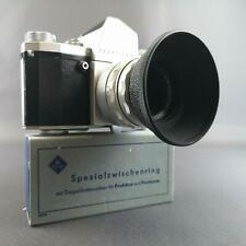 Biotar 2/58 mm mit M42 an Praktica IV M, Streulichtblende, Doppeldrahtauslöser