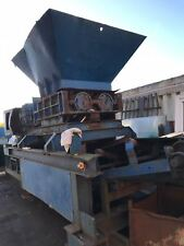 shredder / crusher  wood plastic waste recycling yard on a hooklift RORO frame