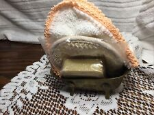 A Tiny Brass Bathtub With A Crochet Washcloth, Soap And Body Scrubber