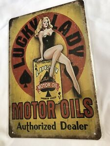 Lady Luck Motor Oil Tin Sign