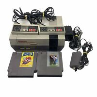 Nintendo NES Console With 2 controllers, cables, and two games.  Super Mario 3