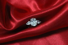 Diamond Engagement 3 stone Ring GIA Certified 5.20 Carat Oval and Pear Cut