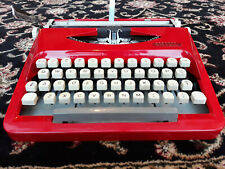 Beautiful red Royal portable vintage typewriter with case