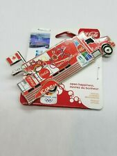 VANCOUVER 2010 OLYMPIC - COCA COLA TRUCK 2 SPONSOR PIN - ON ORIGINAL CARD.
