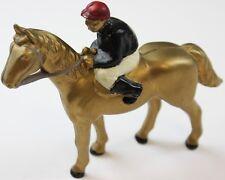 Phipps Stables (Black Silks w/ Cherry Cap) Jockey on Gilt Racehorse