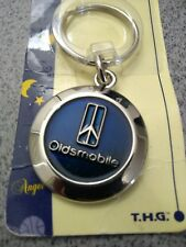 Vintage Oldsmobile Key chain Made in USA Metal Round Chrome with Blue