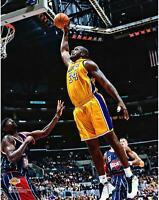 Shaquille O'Neal Los Angeles Lakers Unsigned Yellow Jersey Dunking Photograph