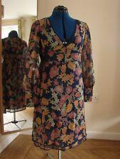 Karen Millen  size 12 silk multi-coloured knee length  dress, with fab sleeves