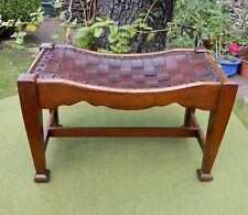 GORDON RUSSELL ATTRIBUTED ARTS & CRAFTS OAK AND WOVEN LEATHER FOOT STOOL