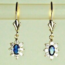 14k solid y/gold lab. created 5x3mm oval Sapphire & CZ nice earrings leverback