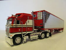 DCP 1/64 SCALE KENWORTH K-100 RED & WHITE WITH RED & CHROME REEFER TRAILER