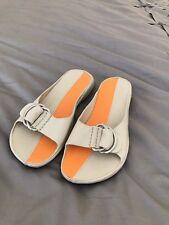 Cole Haan G Series Nike Air Women Sz 6.5 B Orange and cream/gray buckle Sandals