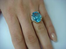 14K YELLOW GOLD LARGE BLUE TOPAZ AND DIAMONDS CLASSIC RING 7.4 GRAMS, SIZE 5