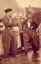 VOLENDAM. Netherlands. two men and two women in traditional garb
