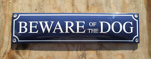 'BEWARE OF THE DOG' ENAMEL SIGN. WHITE TEXT ON A BLUE BACKGROUND. 33x8cm.
