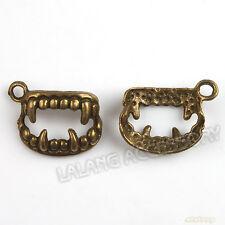 60pcs Lot Vintage Antique Bronze Evil Teeth Shape Charms Pendant Fits Findings J
