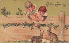 EASTER GREETING~YOUNG BOY & GIRL WATCH RABBITS & EGGS OVER FENCE POSTCARD c1918