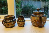 Antique Royal Doulton Pottery  Tea Set with a  Silver Rim