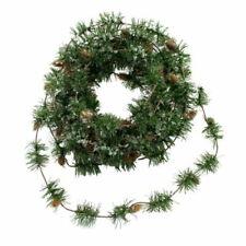 Ghirlande, corone e fiori natalizi marrone