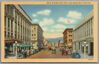Postcard San Bernardino CA E Street view from Third vintage cars Martha's Cafe