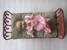 "Victorian Era Cast Iron Doll Bed with bedding and vintage doll 15 1/4"" x 8 1/2"""