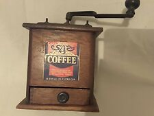 Antique coffee grinder.tasty_food products texas.