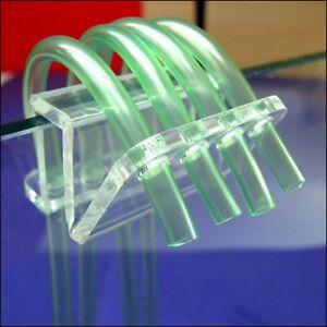 Tube fixture holder for dosing pump or balling