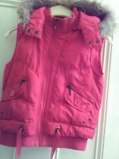 Girls.Age 10-11 years. Height 140-146 cams.Red, hooded, padded,body warmer,gilet