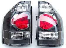 MITSUBISHI PAJERO SHOGUN MONTERO rear tail set lights 2003-2006 BLACK NEW