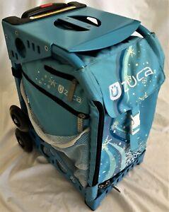 Zuca Frame & Bag for Ice Skates, Sky Blue Frame with 'Wonderland' Pattern Bag
