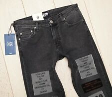NEU LEE 125 x CHEAP MONDAY ALL GENDER SKINNY BLACK JEANS PATCHES 101 32/34