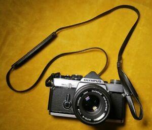 Olympus OM-2N Body in Black + OM 50mm f/1.8 Lens.