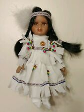 Realistic Native American Porcelain Doll In White Velvet Outfit. 9 in