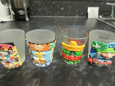 A set of four beautifully decorated Cuban shot glasses